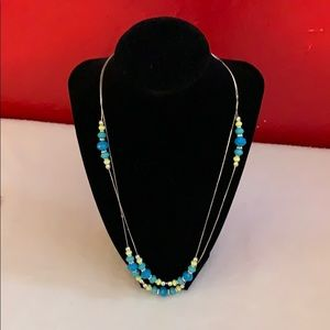 Long silver necklace with blue beads